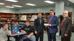 Meyersdale Superintendent Dr. Tracey Karlie, Michael Paulman, Region President Citizens Neighborhood Bank, and Tim Resh, Board Member Riverview Bank and Riverview Financial with Meyersdale students