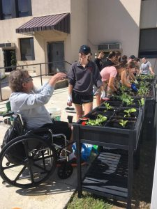 Students from St. Francis University work with seniors at Cambria Care Center in Ebensburg, thanks to a grant through CFA's Youth Philanthropy Interns program.