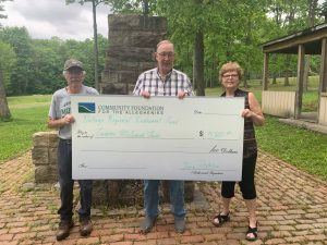 George Fetsko (center) of the Portage Regional Endowment Fund presents a grant check for pool maintenance at Crichton McCormick Park to Dave Squillario (left), vice chair of the Portage Area Join Recreation Commission, and Kathy Hough (right), commission chair.