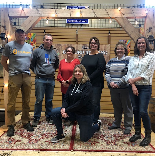 Pictured, left to right, are: Dave Heller, Michael Whelan, Terri Adomnik, Katie Fink, Denise Mock, Mindy Bowling. Front: Mary Heller.